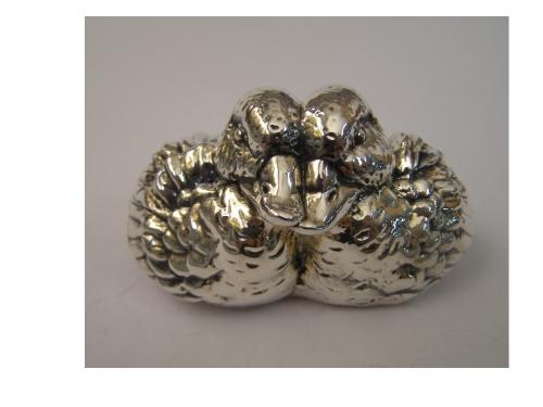 Silver Huging Ducks